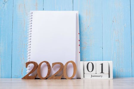 2020 Happy New Year with blank notebook and wooden number. time for a New Start, Resolution, goal, Plan, Action and Mission Concept