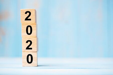 2020 new year wooden cubes on blue table background with copy space for text. Business Goals, Mission, Resolution, New Year New You concept
