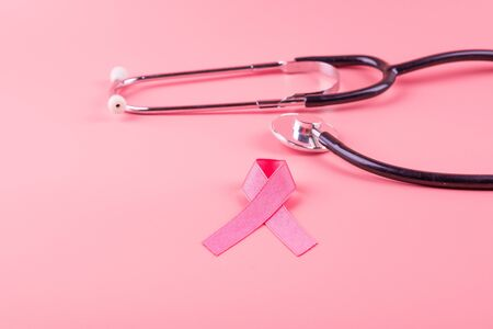 Breast Cancer Awareness, Pink Ribbon with Stethoscope for supporting people living and illness. Woman Healthcare and World cancer day concept Stok Fotoğraf