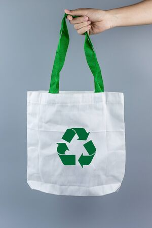 Man holding Eco Shopping bag on gray background with Copy space for text. Environmental Protection, Zero waste, Reusable, Say No Plastic, World Environment day and Earth day concept Reklamní fotografie