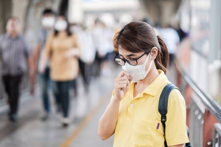 young Asian woman wearing protection mask.