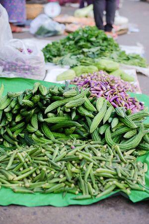 Fresh vegetables on street local shop in Zegyo Market at morning. Mandalay, Myanmar