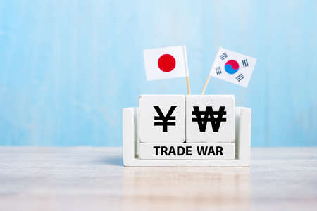 Japan and Korea trade war concept. Japanese Yen and Korean Won symbol with flags