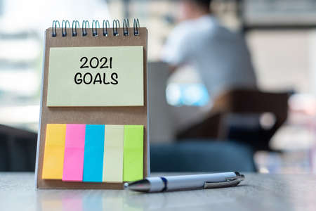 2021 Goal word on note paper with pen on wooden table. Resolution, strategy, solution, goal, business, New Year New You and happy holiday concepts Reklamní fotografie