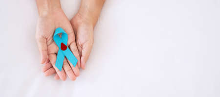 November World Diabetes day Awareness month, Woman holding light Blue Ribbon with blood drop for supporting people living, prevention and illness. Healthcare, prostate cancer day concept Imagens