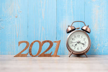 2021 Happy New Year with retro alarm clock and wooden number. New Start, Resolution, Goals, Plan, Action and Mission Concept