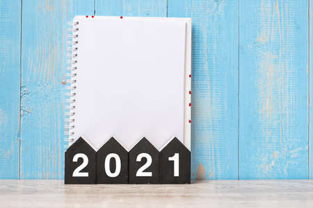 2021 Happy New Year with blank notebook and wooden number. time for a New Start, Resolution, goal, Plan, Action and Mission Concept