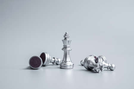 Chess king figure stand out from crowd of enermy or opponent during chessboard competition. Strategy, Success, management, business planning, disruption, win and leadership concept
