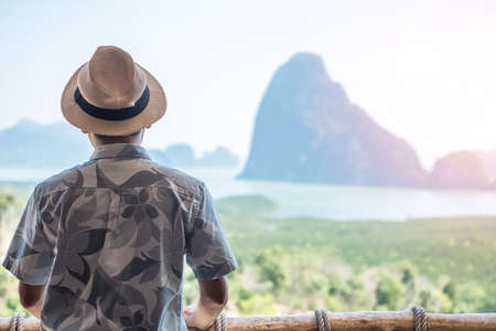 Happy traveler man enjoy Phang Nga bay view point, alone Tourist relaxing at Samet Nang She, near Phuket in Southern Thailand. Southeast Asia travel, trip and summer vacation concept Standard-Bild