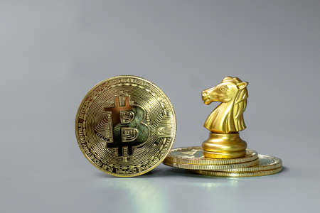 golden Bitcoin cryptocurrency coin stack and Chess Knight piece, Crypto is Digital Money within the blockchain network, is exchanged using technology and online internet exchange. Financial concept