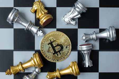 golden Bitcoin cryptocurrency coin stack and Chess piece on chessboard, Crypto is Digital Money of blockchain network, is exchanged using technology and online internet exchange. Financial concept
