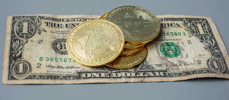 golden Bitcoin cryptocurrency coin stack on US dollar background, Crypto is Digital Money within the blockchain network, is exchanged using technology and online internet exchange. Financial concept