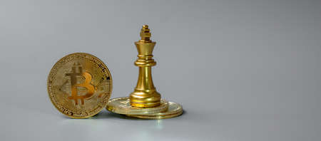 golden Bitcoin cryptocurrency coin stack and Chess King piece, Crypto is Digital Money within the blockchain network, is exchanged using technology and online internet exchange. Financial concept