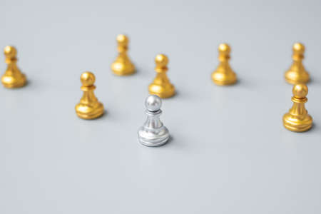 golden chess pawn pieces stand out of people. Different, unique, individual and Social distancing prevent coronavirus infection concept