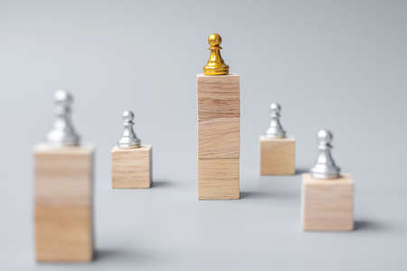 top of golden chess pawn pieces or leader businessman. victory, leadership, business success, team, recruiting, and teamwork concept