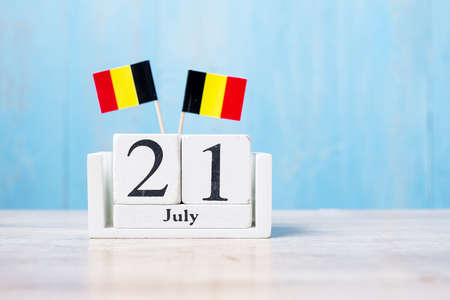 Wooden calendar of July 21th with miniature Belgium flags. Belgian National Day and happy celebration concepts Reklamní fotografie