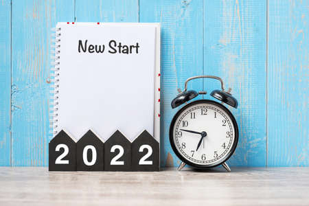 2022 Happy New Year with New start, black retro alarm clock and wooden number.Resolution, Goals, Plan, Action and Mission Concept Reklamní fotografie