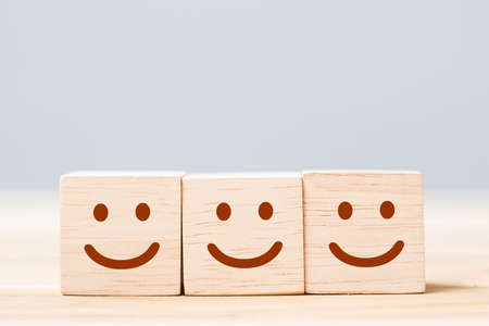 smile face symbol on wooden cube blocks. Emotion, Service rating, ranking, customer review, satisfaction and feedback concept Reklamní fotografie