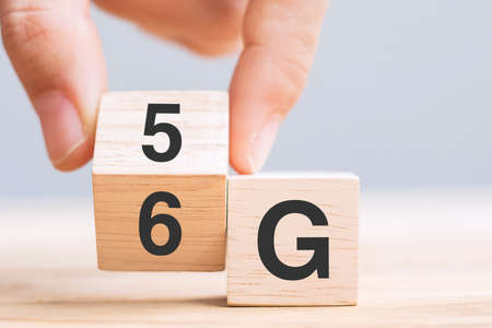 Businessman hand change wooden block from 5G to 6G (Generation of Cellular Mobile Communications) Technology, network, Social media and digital concepts
