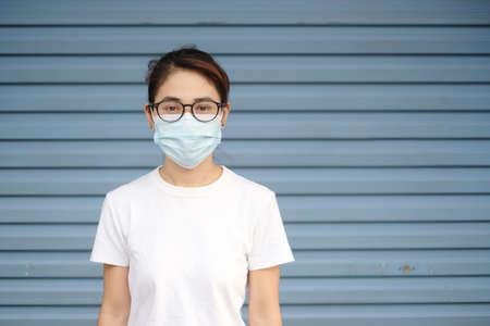 Woman wearing medical face mask, prevent coronavirus or Corona Virus Disease (Covid-19). Health concept Reklamní fotografie