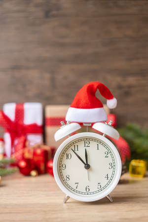 Merry Christmas with Vintage alarm clock and Xmas decoration on wooden table. party, holiday and boxing day concept