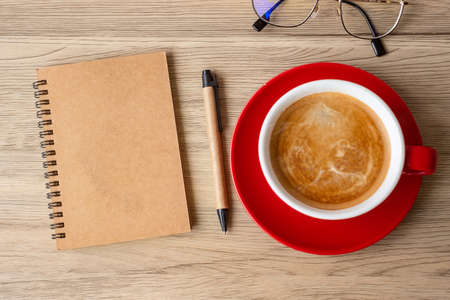blank notebook and coffee cup on wood table. Motivation, Resolution, To do list, Strategy and Plan concept