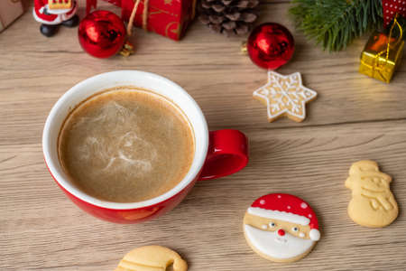 Merry Christmas with homemade cookies and coffee cup on wood table background. Xmas eve, party, holiday and happy New Year concept