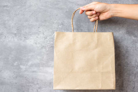 Eco friendly shopping bag on wall background. natural container. zero waste, pollution, earth day, free plastic, world Environment day concept