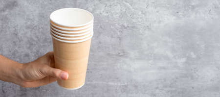 Eco friendly food packaging or takeaway coffee cup. Hand holding natural container for to go. zero waste, pollution, earth day, free plastic, world Environment day concept