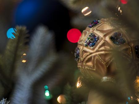 Christmas Tree with Elegant Jeweled Ornament Stock Photo