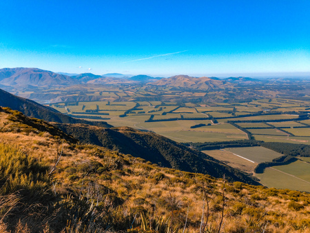 view over Mount Hutt mountainous landscape on a sunny day, near Methven, South Island, New Zealand Фото со стока