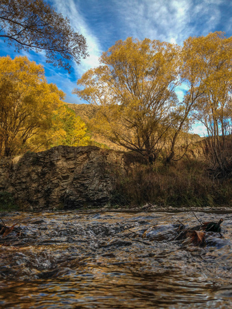small river on a sunny autumn day near Queenstown, New Zealand