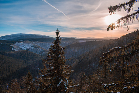 view to Brocken mountain peak covered in snow, in Harz Mountains, Germany
