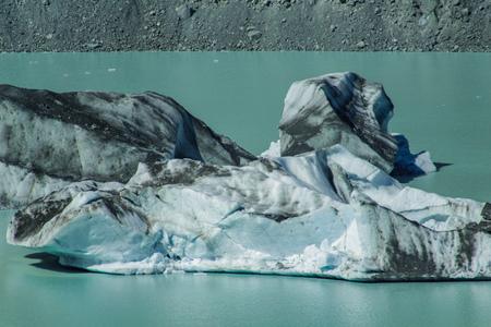 Giant floating icebergs on Tasman Glacier Lake in Aoraki Mount Cook National Park, South Island of New Zealand