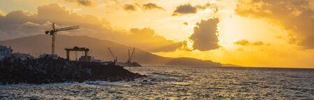 beautiful golden sunrise at Ponta Delgada port, Sao Miguel Island, Azores, Portugal