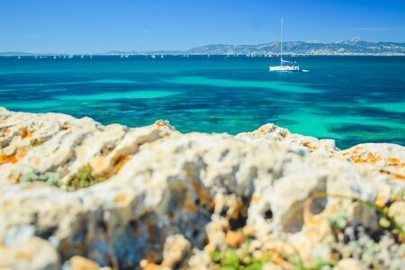 summer weather in Spain. view over beautiful coast with sailing boats in the south of Mallorca, Spain