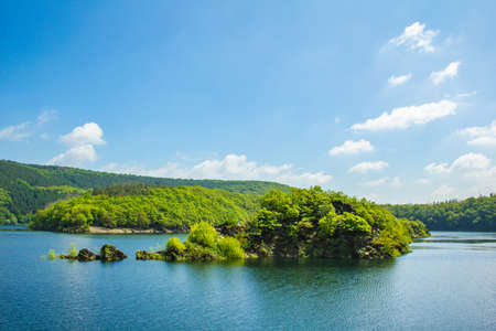 Lake Urft at Eifel National Park, Germany. Scenic view of lake and river Urft and surrounded lush green landscape in North Rhine-Westphalia