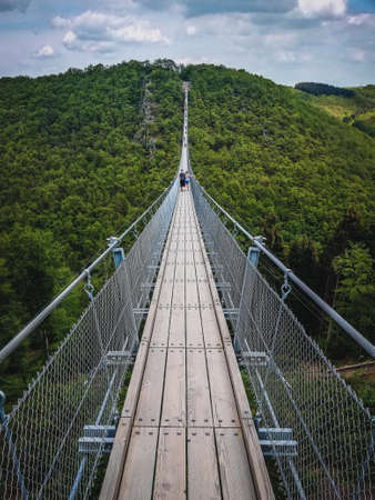 Geierlay Suspension Bridge in the Hunsrück Mountain Range. It is the second longest suspension bridge in Germany and a famous tourist attraction.