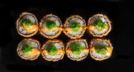 rolls isolated on black background. Photo for the menu