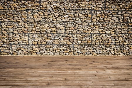 Wooden slats and gabion wall filled with boulders photo