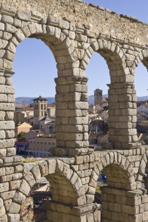 millan: Aqueduct of Segovia, San Millan and Santiago churches behindView of the arches of the aqueduct of Segovia with the Romanesque churches of San Millan and Santiago in the background Aqueduct, Segovia, Roman stone roman arch, church, San Milln, Santiago