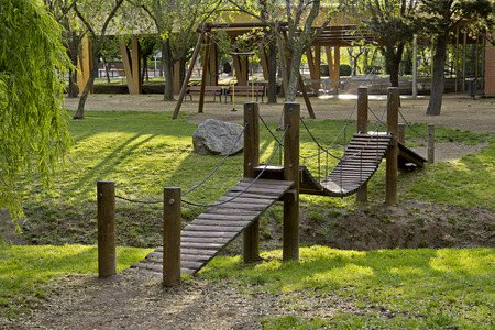 Little hanging bridge for children in a public park in Cardedeu, Spain photo