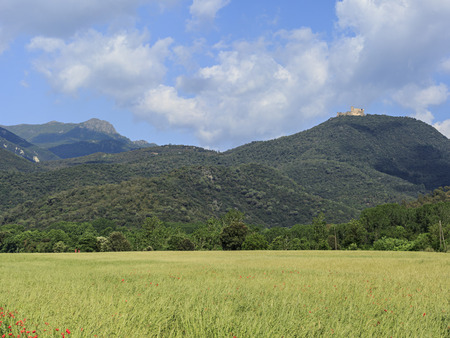 Agricultural landscape and the Castle of Arbucies in Montseny Massif, Spain photo