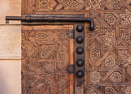 Door and latch in the Alhambra in Granada Spain Stock Photo