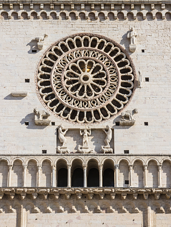 Rosette on the facade of the Cathedral of San Rufino, Assisi, Umbria, Italy