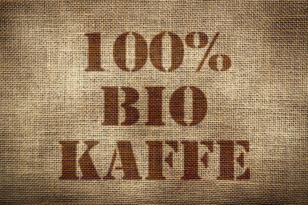 coffee sack: 100% Organic Coffee sack german version Stock Photo