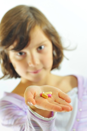 little girl  with pills in hand Stock Photo