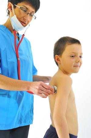 female doctor examining little child boy Stock Photo - 8784188