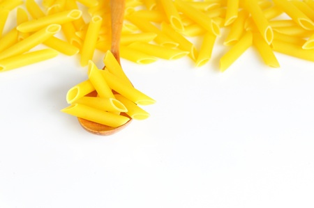 Penne and spoon Stock Photo - 9190807