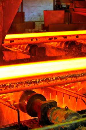 hot steel on conveyor Stock Photo - 11931612
